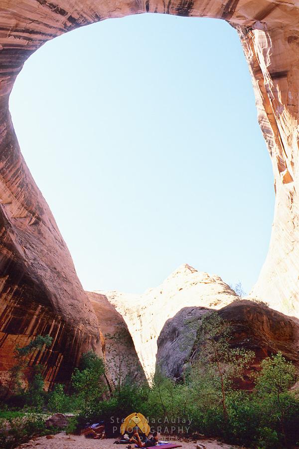 Campsite beneath massive natural amphitheater, Coyote Gulch, Grand Staircase Escalante, National Monument, Utah
