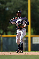 GCL Yankees 2 shortstop Yancarlos Baez (68) warmup throw to first during the first game of a doubleheader against the GCL Pirates on July 31, 2015 at the Pirate City in Bradenton, Florida.  GCL Pirates defeated the GCL Yankees 2 2-1.  (Mike Janes/Four Seam Images)