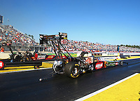 Mar 14, 2014; Gainesville, FL, USA; NHRA top fuel dragster driver Terry McMillen (near lane) races alongside David Grubnic during qualifying for the Gatornationals at Gainesville Raceway Mandatory Credit: Mark J. Rebilas-USA TODAY Sports