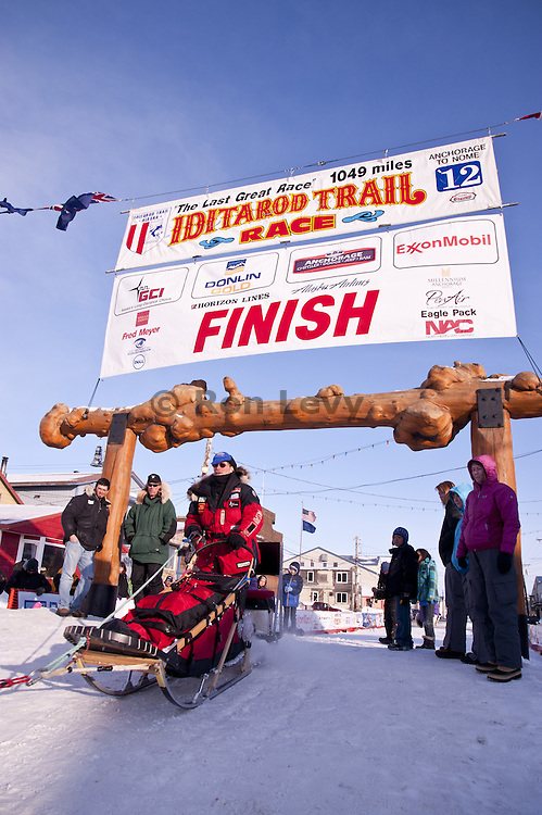 Paul Gebhardt arrives at the finish line in Nome, Alaska during Iditarod Dogsled Race, 2012