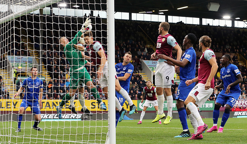 Everton's Jordan Pickford clears under pressure from Burnley's James Tarkowski<br /> <br /> Photographer Rich Linley/CameraSport<br /> <br /> The Premier League - Burnley v Everton - Saturday 5th October 2019 - Turf Moor - Burnley<br /> <br /> World Copyright © 2019 CameraSport. All rights reserved. 43 Linden Ave. Countesthorpe. Leicester. England. LE8 5PG - Tel: +44 (0) 116 277 4147 - admin@camerasport.com - www.camerasport.com