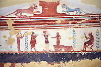 Underground Etruscan tomb  A single chamber with double sloping ceiling. In the tympanium are two wild animals below wich is a scene with a portait of the deceased seated watching a dancer and a flute player. Circa 400 BC, Etruscan Necropolis of Monterozzi, Monte del Calvario, Tarquinia, Italy. A UNESCO World Heritage Site.