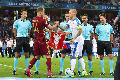 15.06.2016. Lille, France. UEFA Euro 2016 Group B soccer match Russia and Slovakia at Stade Pierre Mauroy in Lille Metropole, France, 15 June 2016.  Vasili Berezutski (Rus)shakes hands with Martin Skrtel (Slo)