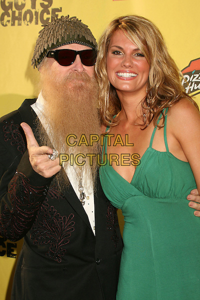 "BILLY GIBBONS (ZZ TOP) & COURTNEY HANSEN.Spike TV's ""Guy Choice"" Awards - Arrivals at Radford Studios, Studio City, California, USA..June 9th, 2007.half length green dress black beard hat sunglasses shades facial hair pointing hand jacket.CAP/ADM/BP.©Byron Purvis/AdMedia/Capital Pictures"