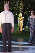 "11 July 2014, Muelheim/Ruhr, Germany. L-R: Volker Roos as Creon/Kreon, Simone Thoma as Antigone and Fabio Menendez as Haimon. Roberto Ciulli's ""Theater an der Ruhr"" perform ""Antigone"" as part of their open-air season ""Weisse Naechte"" (White Nights) in Raffelbergpark, Muelheim an der Ruhr, Germany."