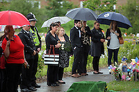 Pictured: Mourners attend the burial of baby Sion at Thornhill Cemetery, Cardiff, Wales, UK. Tuesday 28 June 2016<br /> Re: The funeral of Sion, the baby boy found dead in the River Taff in Cardiff has taken place<br /> Generous locals raised nearly &pound;1,400 for the memorial after reading about plans to hold a fitting ceremony for the newborn baby whose body was discovered in Cardiff a year ago.<br /> The funeral took place at the Briwnant Chapel at Thornhill Crematorium, Cardiff. Members of the public are invited to be among the congregation.