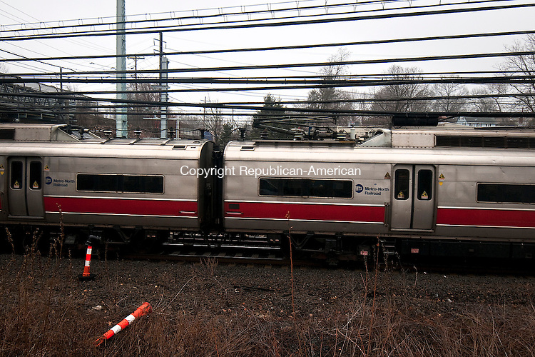 MILFORD,  CT,  CT-041015JS01- A Metro-North train passes by the new Devon Transfer station which is being built in Milford on Friday. The station which will be used while the Housatonic Railroad Bridge undergoes repairs, is for the Waterbury line to make connections to New Haven. <br /> Jim Shannon Republican-American