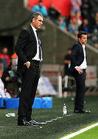 (L-R) Swansea manager Paul Clement and Watford manager Marco Silva stand on their touch lines during the Premier League match between Swansea City and Watford at The Liberty Stadium, Swansea, Wales, UK. Saturday 23 September 2017