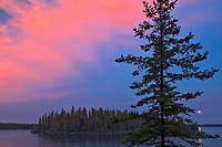 Lake Athapapuskow at dusk with moon<br />
