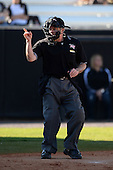 Umpire Mike Trotter makes a call during a game between the Siena Saints and Central Florida Knights at Jay Bergman Field on February 16, 2014 in Orlando, Florida.  UCF defeated Siena 9-6.  (Copyright Mike Janes Photography)