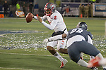 New Mexico quarterback Tevaka Tuioti (8) gets away from Nevada's Dom Peterson in the second half of an NCAA college football game in Reno, Nev., Saturday, Nov. 2, 2019. (AP Photo/Tom R. Smedes)