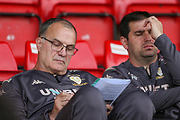 Leeds United manager Marcelo Bielsa chats through his notes with assistant Pablo Quiroga<br /> <br /> Photographer Alex Dodd/CameraSport<br /> <br /> Football Pre-Season Friendly - York City v Leeds United - Wednesday 10th July 2019 - Bootham Crescent - York<br /> <br /> World Copyright © 2019 CameraSport. All rights reserved. 43 Linden Ave. Countesthorpe. Leicester. England. LE8 5PG - Tel: +44 (0) 116 277 4147 - admin@camerasport.com - www.camerasport.com