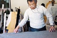 MAY 15, 2014 - KOJIMA, KURASHIKI, JAPAN: Totaro Yamashita cuts Denim fabric for hand made ordered jeans at the Betty Smith's factory. (Photograph / Ko Sasaki)