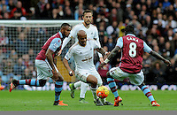 Andre Ayew of Swansea City tackled by Idrissa Gueye of Aston Villa during the Barclays Premier League match between Aston Villa v Swansea City played at the Villa Park Stadium, Birmingham on October 24th 2015
