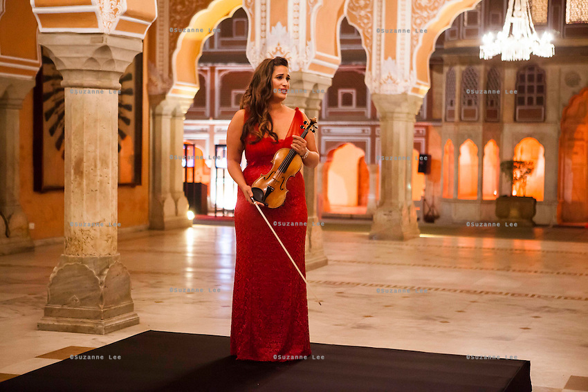 Australian violinist Niki Vasilakis speaks of her music as she plays the violin during a recital at the OzFest Gala Dinner in the Jaipur City Palace, in Rajasthan, India on 10 January 2013. Photo by Suzanne Lee