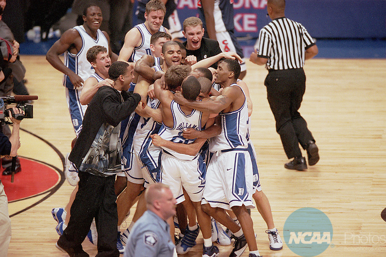 02 APR 2001:  Duke celebrates its victory over the University of Arizona during the NCAA Men's Basketball Final Four Championship game held in Minneapolis, MN at the Hubert H. Humphrey Metrodome. Duke defeated Arizona 82-72 for the championship. Brian Gadbery/NCAA Photos