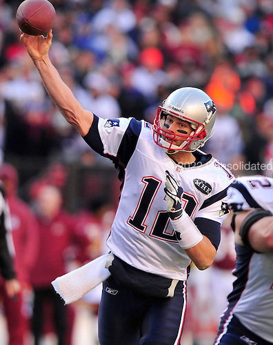 New England Patriots quarterback Tom Brady (12) releases a pass in the second quarter against the Washington Redskins at FedEx Field in Landover, Maryland on Sunday December 11, 2011..Credit: Ron Sachs / CNP.(RESTRICTION: NO New York or New Jersey Newspapers or newspapers within a 75 mile radius of New York City)