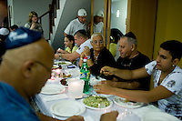 Sami (2nd from right) and Neta (3rd from right) Reshef ( (more details in portrait photos).Jewish residents of the popular Thai tourist island of Koh Samui gather  for a party at Rabbi Goldshmid's (unseen) home during Chanuka on 15th December 2009. .Koh Samui is the smaller of 2 islands next to each other, world renowned for the monthly full moon rave parties on the beach..Photo by Suzanne Lee / For Chabad Lubavitch