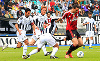 "Calcio, Serie A: Siena-Milan. Siena, stadio ""Artemio Franchi"" , 29 aprile 2012..Football, Italian serie A: Siena vs AC Milan. Siena's ""Artemio Franchi"" stadium, 29 april 2012. AC Milan forward Zlatan Ibrahimovic, of Sweden, right, is chased by Siena midfielder Simone Vergassola, and defenders Alessandro Gazzi, second from left, and Matteo Contini..UPDATE IMAGES PRESS/Riccardo De Luca"