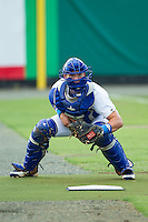 Burlington Royals catcher Chase Vallot (8) warms up the starting pitcher in the bullpen prior to the game against the Elizabethton Twins at Burlington Athletic Park on June 25, 2014 in Burlington, North Carolina.  The Twins defeated the Royals 8-0. (Brian Westerholt/Four Seam Images)