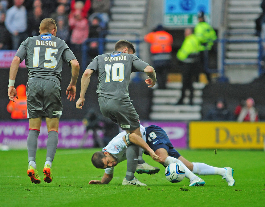 Preston North End's John Welsh vies for possession with Rotherham United's Michael O'Connor <br /> <br /> Photographer Chris Vaughan/CameraSport<br /> <br /> Football - The Football League Sky Bet League One Play-Off First Leg - Preston North End v Rotherham United - Saturday 10th May 2014 - Deepdale - Preston<br /> <br /> &copy; CameraSport - 43 Linden Ave. Countesthorpe. Leicester. England. LE8 5PG - Tel: +44 (0) 116 277 4147 - admin@camerasport.com - www.camerasport.com
