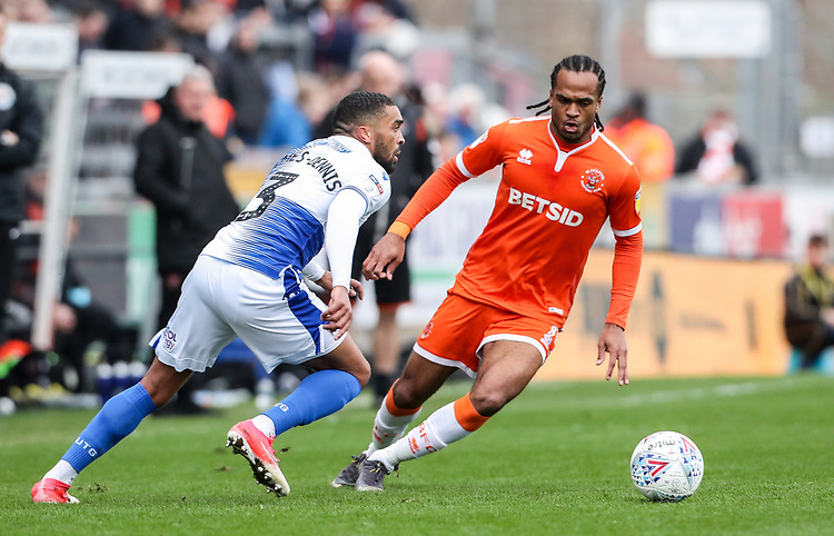 Blackpool's Nathan Delfouneso competing with Bristol Rovers' Tareiq Holmes-Dennis <br /> <br /> Photographer Andrew Kearns/CameraSport<br /> <br /> The EFL Sky Bet League Two - Bristol Rovers v Blackpool - Saturday 2nd March 2019 - Memorial Stadium - Bristol<br /> <br /> World Copyright © 2019 CameraSport. All rights reserved. 43 Linden Ave. Countesthorpe. Leicester. England. LE8 5PG - Tel: +44 (0) 116 277 4147 - admin@camerasport.com - www.camerasport.com