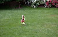 Child, in a summer garden, New Jersey
