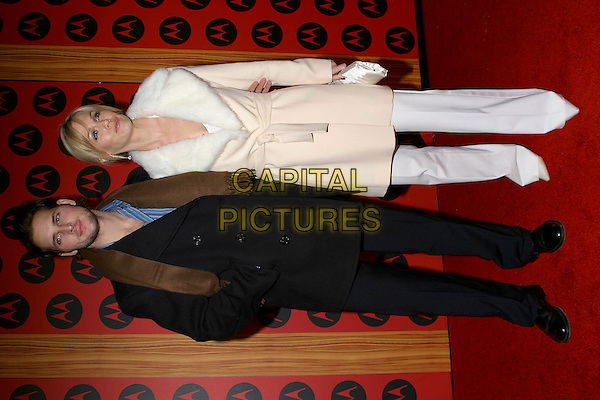 JENNIE GARTH & PETER FACINELLI.Motorola's Sixth Anniversary Party to Benefit Toys For Tots held at the Music Box Theatre, Hollywood, California, USA, 2nd December 2004..full length white cream coat fur collar.**UK SALES ONLY**.Ref: ADM.www.capitalpictures.com.sales@capitalpictures.com.©J.Wong/AdMedia/Capital Pictures .