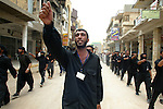 Shiite insurgents march in the streets of Najaf, Iraq on May 27, 2004.  (photo by Khampha Bouaphanh)