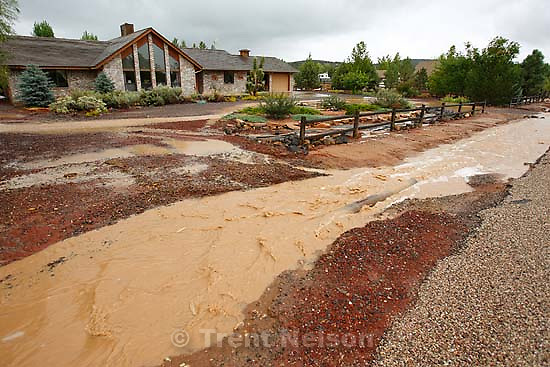 Dammeron Valley - Saturday's rains in southern Utah caused flooding, in this case washing out the driveway to Brooks Baker's home in Dammeron Valley.