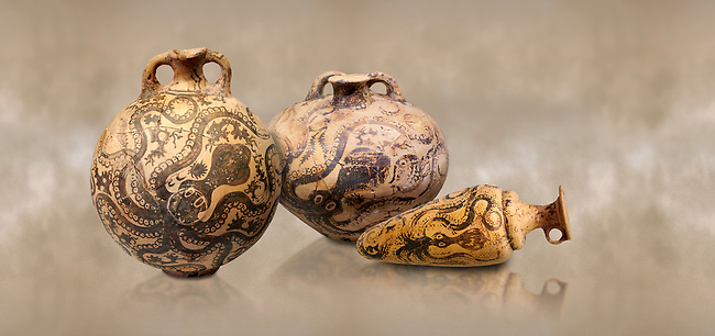 Minoan pottery with stylised octopus decorations, 1500-1400 BC, Heraklion Archaeological Museum.  <br /> <br /> From Left to right<br /> 1- flask with Marine style stylised octopus design,   Palaikastro,  1500-1450 BC; <br /> 2.Minoan clay flask with octopus design, Speial Palatial Style , Pseira  1500-1400 BC BC, <br /> 3- conical rhython with Marine style stylised octopus design,   Palaikastro 1500-1450 BC;