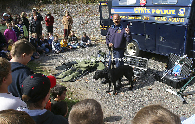 PLYMOUTH, CT. 24 October 2006--102406SV02--Trooper Pablo Arroyo and his bomb sniffing dog &quot;Ozzy&quot; give a demonstration at the Harry S. Fisher Middle School in Plymouth Tuesday. The event was part of the National Red Ribbon Campaign, which promotes anti-drug awareness.<br /> Steven Valenti Republican-American