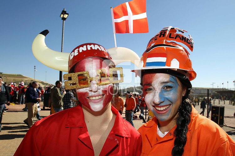 Denmark and Holland fans outside the Soccer City stadium before the game .