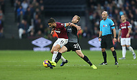 Burnley's Matej Vydra gets an elbow in the face from West Ham United's Robert Snodgrass<br /> <br /> Photographer Rob Newell/CameraSport<br /> <br /> The Premier League - West Ham United v Burnley - Saturday 3rd November 2018 - London Stadium - London<br /> <br /> World Copyright &copy; 2018 CameraSport. All rights reserved. 43 Linden Ave. Countesthorpe. Leicester. England. LE8 5PG - Tel: +44 (0) 116 277 4147 - admin@camerasport.com - www.camerasport.com