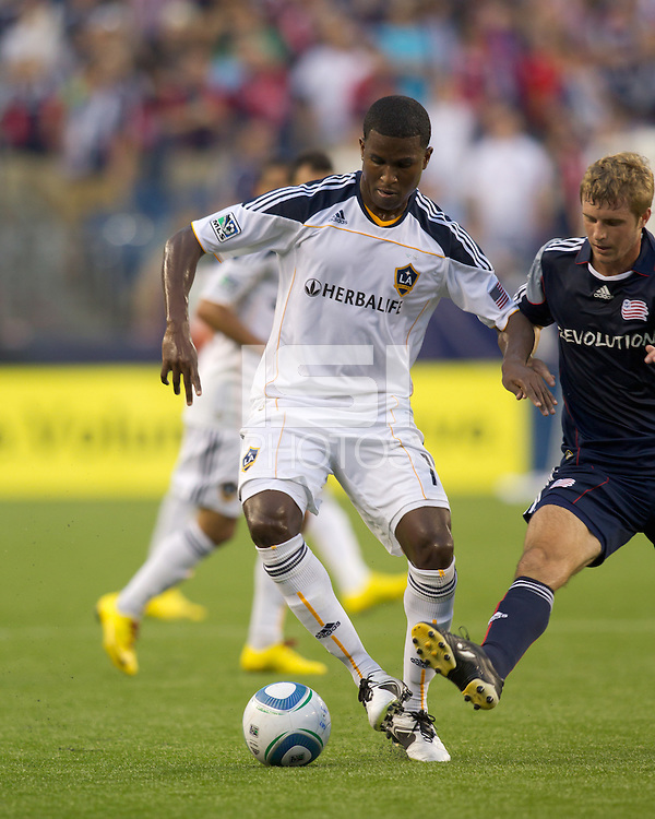 Los Angeles Galaxy forward Edson Buddle (14) dribbles as New England Revolution midfielder Jason Griffiths (16) pressures. The New England Revolution defeated LA Galaxy, 2-0, at Gillette Stadium on July 10, 2010.