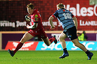 (L-R) Rhys Patchell of the Scarlets closely followed by Keiron Assiratti of Cardiff Blues during the Guinness PRO14 match between Scarlets and Cardiff Blues at Parc Y Scarlets Stadium, Llanelli, Wales, UK. Saturday 28 October 2017