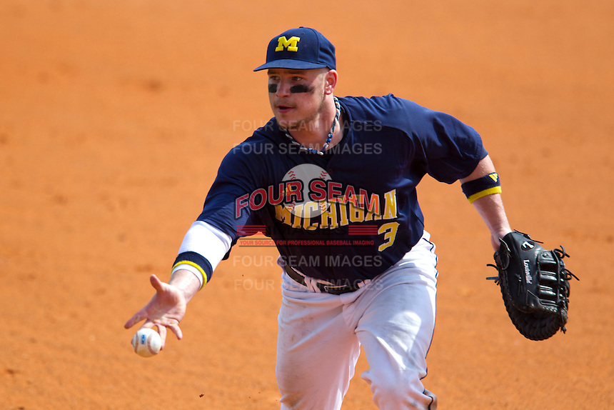 Michigan Wolverines first baseman Coley Crank #3 flips the ball to the pitcher (not pictured) covering first during a game against the Seton Hall Pirates at the Big Ten/Big East Challenge at Al Lang Stadium on February 18, 2012 in St. Petersburg, Florida.  (Mike Janes/Four Seam Images)