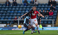 Jon Ashton of Crawley Town fouls Aaron Pierre of Wycombe Wanderers during the Sky Bet League 2 match between Wycombe Wanderers and Crawley Town at Adams Park, High Wycombe, England on 28 December 2015. Photo by Andy Rowland / PRiME Media Images
