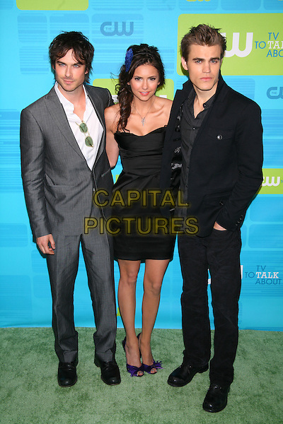 IAN SOMERHALDER, NINA DOBREV & PAUL WESLEY.The CW Network's Upfront 2010 held at Madison Square Garden, New York, NY, USA..May 20th, 2010.full length grey gray suit whit shirt black dress.CAP/LNC/TOM.©TOM/LNC/Capital Pictures.