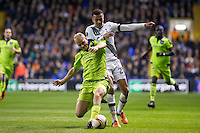 Olivier Deschacht of R.S.C Anderlecht tackles Dele Alli of Tottenham Hotspur during the UEFA Europa League Group J match between Tottenham Hotspur and R.S.C. Anderlecht at White Hart Lane, London, England on 5 November 2015. Photo by Andy Rowland.