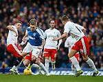 Martyn Waghorn crowded out by Falkirk defenders