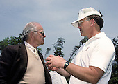 Washington Redskins owner Jack Kent Cooke, left, and head coach Joe Gibbs, right, discuss strategy during the team's mini-camp at Redskins Park in Herndon, Virginia during May, 1986.<br /> Credit: Arnold Sachs / CNP