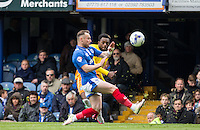 Gozie Ugwu of Wycombe Wanderers crosses the ball during the Sky Bet League 2 match between Portsmouth and Wycombe Wanderers at Fratton Park, Portsmouth, England on 23 April 2016. Photo by Andy Rowland.
