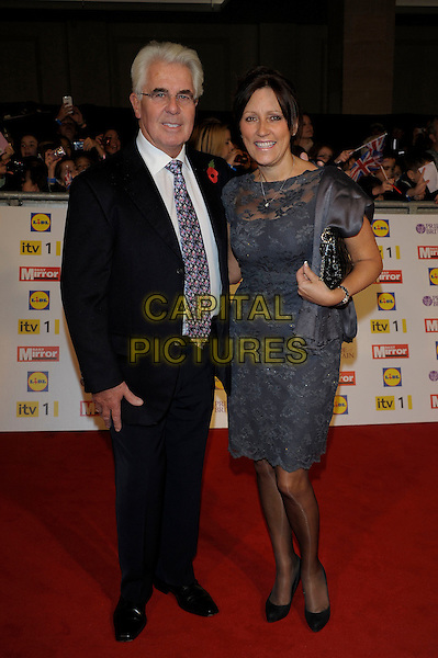 Max Clifford, Jo Westwood.Pride Of Britain awards at Grosvenor House, London, England..29th October 2012.full length grey gray lace dress married husband wife black white tie pink blue pattern glasses  .CAP/PL.©Phil Loftus/Capital Pictures.