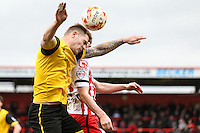 James Collins of Northampton Town wins the aerial battle during the Sky Bet League 2 match between Stevenage and Northampton Town at the Lamex Stadium, Stevenage, England on 19 March 2016. Photo by David Horn / PRiME Media Images.