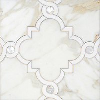 Atticus, a waterjet stone mosaic, shown in honed Calacatta, polished Thassos, and Shell, is part of the Parterre Collection by Paul Schatz for New Ravenna.