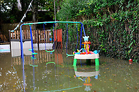 Pictured: Flooding in a back garden caused by Storm Callum, in Carmathen, Wales, UK. Sunday 14 October 2018<br /> Re: The aftermath of the flood caused by the unusually high tide of rover Towy and storm Callum in Carmarthen west Wales, UK.