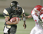 Galena Park's Wendell Williams stares down Crosby linebacker Alvin Baptiste on a kickoff return.  The Galena Park High School Yellow Jackets played the Crosby Cougars October 19, 2007 at the Galena Park ISD District Athletic Complex in a District 21-4A matchup.