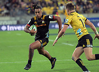 Sean Wainui runs at Jordie Barrett during the Super Rugby match between the Hurricanes and Chiefs at Westpac Stadium in Wellington, New Zealand on Friday, 13 April 2018. Photo: Dave Lintott / lintottphoto.co.nz
