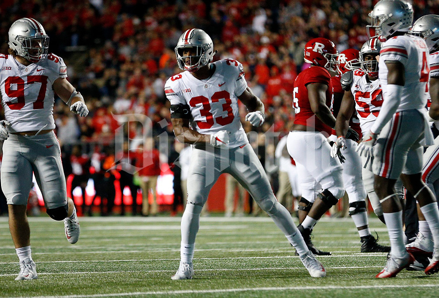 Ohio State Buckeyes linebacker Dante Booker (33) celebrates his interception in the second quarter of their game against the Rutgers Scarlet Knights at the High Point Solutions Stadium on the Rutgers University campus in Pisccataway, NJ on September 30, 2017. [ Brooke LaValley / Dispatch ]